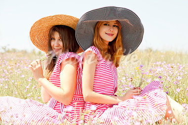 Two girls at contryside in red dresses. Stock Photo - Royalty-Free, Artist: massonforstock                , Code: 400-05663737