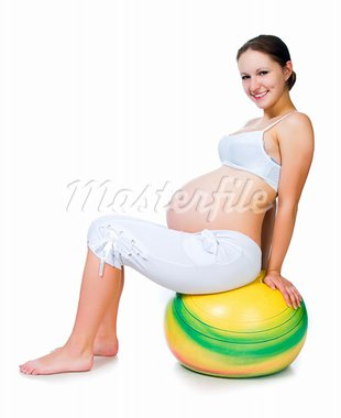 Pregnant woman excercises with gymnastic ball isolated on white Stock Photo - Royalty-Free, Artist: tan4ikk                       , Code: 400-05664247