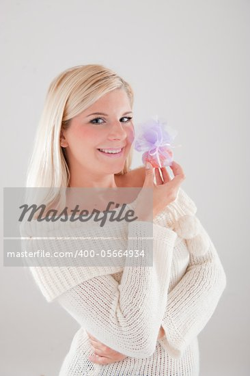 pretty winter girl with christmas present Stock Photo - Royalty-Free, Artist: smartfoto                     , Code: 400-05664934