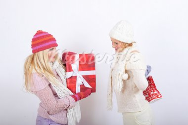 Two pretty winter girls friends making presents Stock Photo - Royalty-Free, Artist: smartfoto                     , Code: 400-05664945