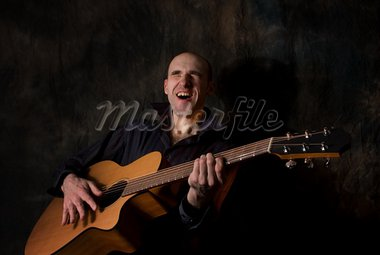 man playing acoustic guitar Stock Photo - Royalty-Free, Artist: spaxiax                       , Code: 400-05665239