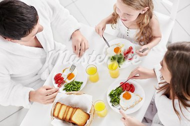 Family with a child has breakfast Stock Photo - Royalty-Free, Artist: Deklofenak                    , Code: 400-05668693
