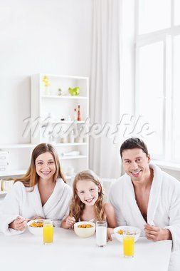 Family with a child has breakfast Stock Photo - Royalty-Free, Artist: Deklofenak                    , Code: 400-05668699