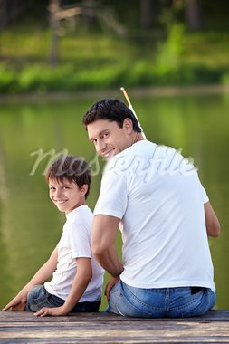 A man and a boy with a fishing rod on the lake Stock Photo - Royalty-Free, Artist: Deklofenak                    , Code: 400-05668797