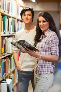 Portrait of young students holding a book in a library Stock Photo - Royalty-Free, Artist: 4774344sean                   , Code: 400-05668941