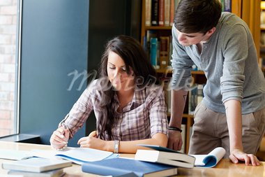 Classmates helping each other in a library Stock Photo - Royalty-Free, Artist: 4774344sean                   , Code: 400-05670097