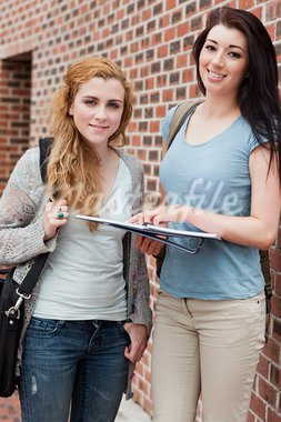 Portrait of a student helping a classmate outside a building Stock Photo - Royalty-Free, Artist: 4774344sean                   , Code: 400-05670696