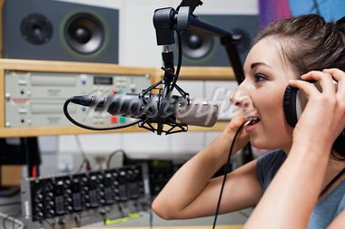 Young radio host speaking through a microphone Stock Photo - Royalty-Free, Artist: 4774344sean                   , Code: 400-05672200