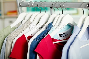 Photo of hangers with different clothes in department Stock Photo - Royalty-Free, Artist: pressmaster                   , Code: 400-05672540