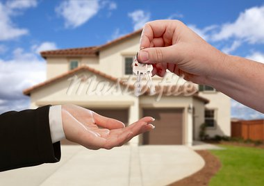Handing Over the House Keys in Front of a Beautiful New Home. Stock Photo - Royalty-Free, Artist: Feverpitched                  , Code: 400-05674174