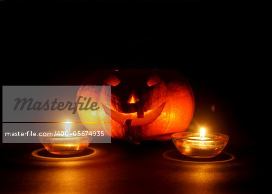 lantern, illuminating pumpkin in dark night Stock Photo - Royalty-Free, Artist: loskutnikov                   , Code: 400-05674935