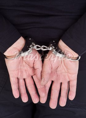 close-up of thief's hands in handcuffs Stock Photo - Royalty-Free, Artist: kmit                          , Code: 400-05676242
