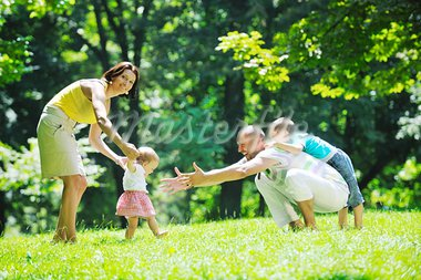happy young couple with their children have fun at beautiful park outdoor in nature Stock Photo - Royalty-Free, Artist: dotshock                      , Code: 400-05676704