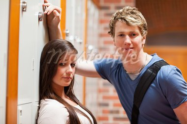 Good looking couple flirting in a corridor Stock Photo - Royalty-Free, Artist: 4774344sean                   , Code: 400-05677853