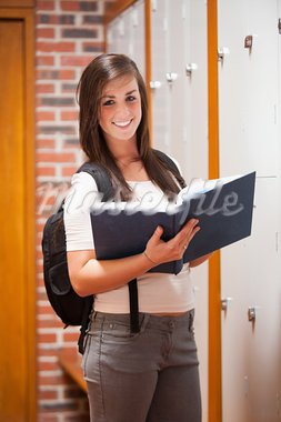 Portrait of a student holding a book in a corridor Stock Photo - Royalty-Free, Artist: 4774344sean                   , Code: 400-05677898