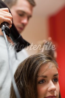 Portrait of a handsome hairdresser blowing hair of a customer Stock Photo - Royalty-Free, Artist: 4774344sean                   , Code: 400-05677952