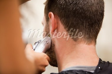 Young man having a haircut with a hair clippers Stock Photo - Royalty-Free, Artist: 4774344sean                   , Code: 400-05677966