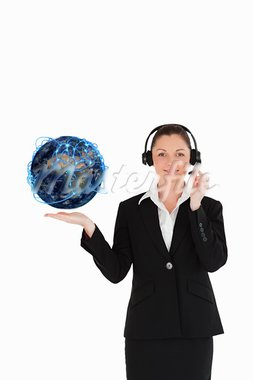 Customer service operator holding a planet globe Stock Photo - Royalty-Free, Artist: 4774344sean                   , Code: 400-05678186