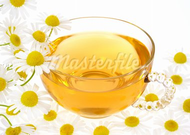 Cup of chamomile tea over white background Stock Photo - Royalty-Free, Artist: brozova                       , Code: 400-05678540