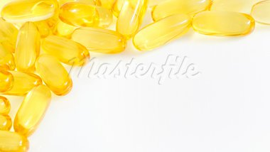 yellow fish oil capsule pile Stock Photo - Royalty-Free, Artist: jordache                      , Code: 400-05681153