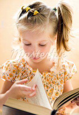 sweet happy little girl reading a book Stock Photo - Royalty-Free, Artist: tan4ikk                       , Code: 400-05681681