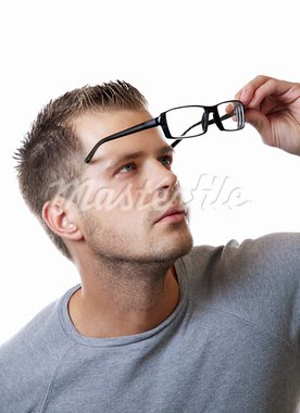 Young man puts his glasses on Stock Photo - Royalty-Free, Artist: tommyandone                   , Code: 400-05683153