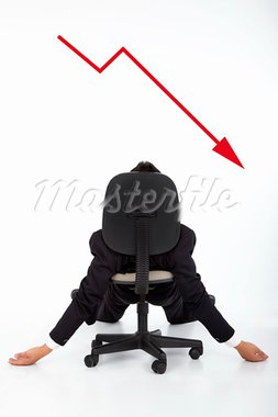 businessman lying on the chair and watching the red down graph Stock Photo - Royalty-Free, Artist: tomwang                       , Code: 400-05683945