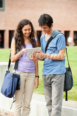 Portrait of a couple holding a tablet computer outside a building Stock Photo - Royalty-Free, Artist: 4774344sean                   , Code: 400-05684097