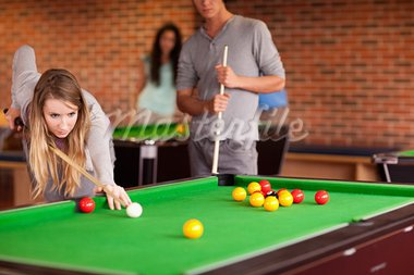 Friends playing snooker in a student home Stock Photo - Royalty-Free, Artist: 4774344sean                   , Code: 400-05684415