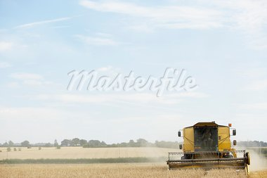 Combine Harvester Working In Field Stock Photo - Royalty-Free, Artist: MonkeyBusinessImages          , Code: 400-05686351