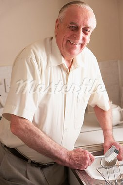 Senior Man Washing Up At Sink Stock Photo - Royalty-Free, Artist: MonkeyBusinessImages          , Code: 400-05686567