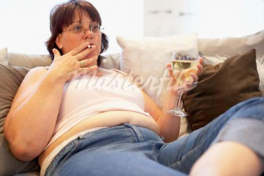 Overweight Woman Relaxing On Sofa Stock Photo - Royalty-Free, Artist: MonkeyBusinessImages          , Code: 400-05686619