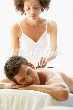 Young Man Enjoying Hot Stone Treatment Stock Photo - Royalty-Free, Artist: MonkeyBusinessImages          , Code: 400-05686669