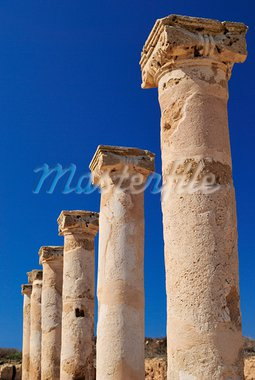 Ancient Greek columns in the ruins against a blue sky. Stock Photo - Royalty-Free, Artist: grauvision                    , Code: 400-05686691