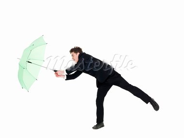 Young man with umbrella isolated on white background Stock Photo - Royalty-Free, Artist: gemenacom                     , Code: 400-05690043