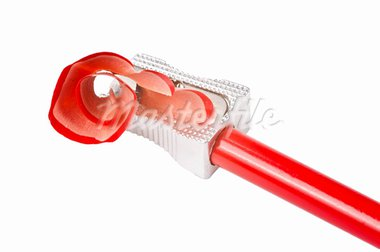 A red sharp pencil being sharpened by a pencil sharpener Stock Photo - Royalty-Free, Artist: ruigsantos                    , Code: 400-05690330