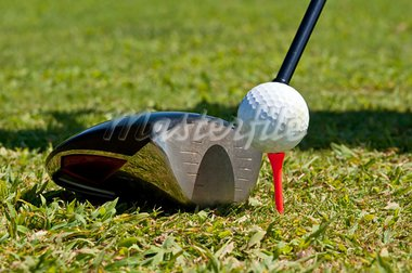 Golf ball and driver, ready to strike, on a real golf course. Stock Photo - Royalty-Free, Artist: ruigsantos                    , Code: 400-05690355