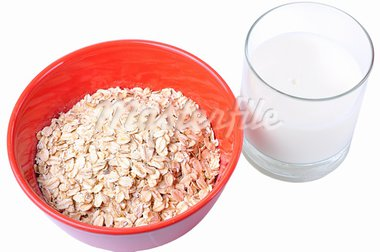 Closeup of a bowl of oatmeal and a glass of milk Stock Photo - Royalty-Free, Artist: ruigsantos                    , Code: 400-05690391
