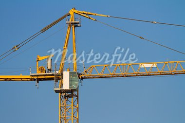 Yellow Crane against Blue Sky Stock Photo - Royalty-Free, Artist: William87                     , Code: 400-05690659