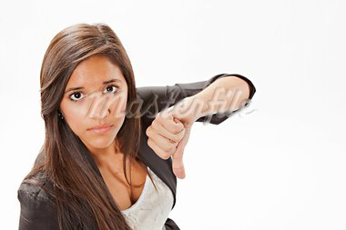 An cute attractive frowning teenage female girl giving the thumbs down sign on a white background. Stock Photo - Royalty-Free, Artist: mkm3                          , Code: 400-05691199