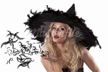 face shot of a cute and sexy girl dressed with a huge witch hat with feathers blowing a kiss Stock Photo - Royalty-Free, Artist: carlodapino                   , Code: 400-05692645