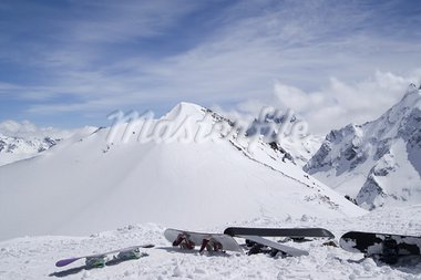 Snowboards against the top of mountain. Caucasus, Dombay. Stock Photo - Royalty-Free, Artist: BSANI                         , Code: 400-05692849