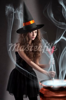 halloween shot of a young and beautiful witch wearing a huge black and orange hat making a poison in a big pot Stock Photo - Royalty-Free, Artist: carlodapino                   , Code: 400-05693470