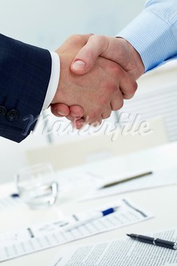Close-up of two shaking hands Stock Photo - Royalty-Free, Artist: pressmaster                   , Code: 400-05694600