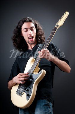 Guitar player against the dark background Stock Photo - Royalty-Free, Artist: ElnurCrestock                 , Code: 400-05695361