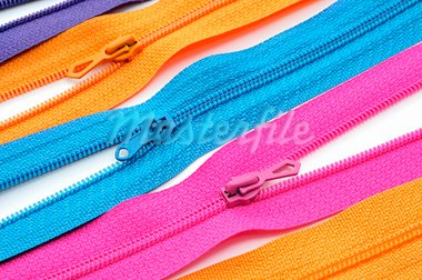 closeup of zippers of different colors on a white background Stock Photo - Royalty-Free, Artist: nito                          , Code: 400-05695456