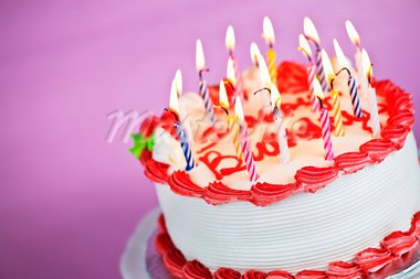 Birthday cake with burning candles on a plate on pink background Stock Photo - Royalty-Free, Artist: Elenathewise                  , Code: 400-05695714