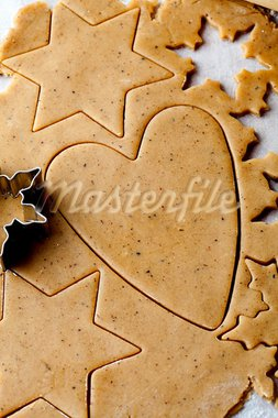 Making gingerbread cookies for Christmas. Gingerbread dough with star shapes and a heart. Stock Photo - Royalty-Free, Artist: ElinaManninen                 , Code: 400-05696402