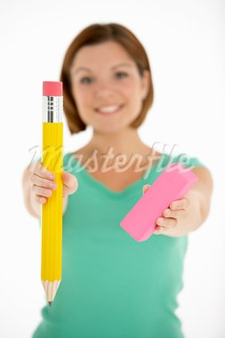 Woman Holding Big Pencil And Eraser Stock Photo - Royalty-Free, Artist: MonkeyBusinessImages          , Code: 400-05696588