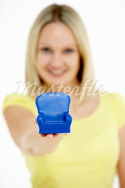 Woman Holding Small Armchair Stock Photo - Royalty-Free, Artist: MonkeyBusinessImages          , Code: 400-05696648